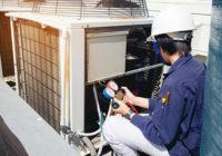 Mechanic replacing air filter